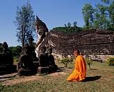 Asia, Laos, Vientiane, Monk at Giant Buddha of Wat Xieng Khuan