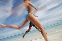 Couple runnning on beach