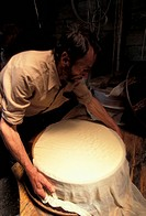 Making Beaufort cheese. Haute Savoie, France