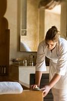 Maid setting a hotel bathroom . Essaouira, Morocco, Africa