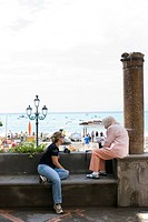 Italy, Campania, Amalfi coast, Positano, People talking on the beach