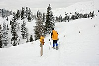 Austria, Carinthia, Villach, Dobratsch Natural Park, People Snowshoeing