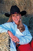 USA, Oregon, Bend, Portrait of cowgirl in barn