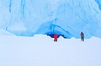 Photographer photographing Antarctic Ice cave .Antarctic Ice shelf , Queen Maud Land ,Antarctica