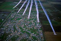 Aerial view of six DC_3 airplanes spraying chemicals for mosquito control on areas of Florida damaged by Hurricane Andrew.