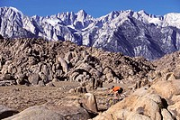 Mountain biking in big boulders in the Alabama Hills near Mount Whitney, California.