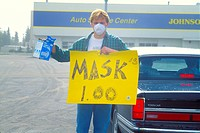 USA, Alaska, Anchorage with volcano ash pollution from Mt Spur 1992 man selling face masks to filter the ash