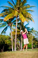 Woman playing golf, Maui Country Club, Spreckelsville, Maui, Hawaii, USA