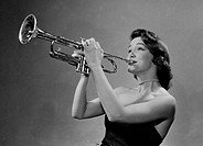 Young woman playing trumpet