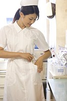 Female nurse checking pocket