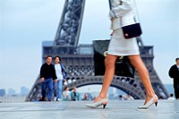 Lady with shopping bag crossing Palais de Chaillot in Trocadero with Eiffel Tower