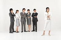 Businesswoman excluded from group of business people