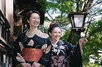 Two young women in kimono walking