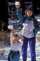 Mother with infant and child age 3 throwing snowballs, Los Padres National Forest, California