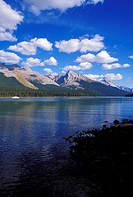 Afternoon light on Mount Sampson from the shore of Maligne Lake ferry visible, Jasper National Park, Alberta, Canada