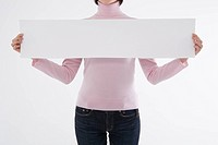 Woman holding blank paper