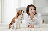 Young woman and cavalier king Charles spaniel
