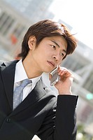 Young businessman talking over mobile phone