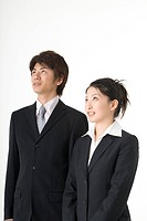 Portrait of young couple wearing suit