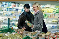 Couple shopping at supermarket