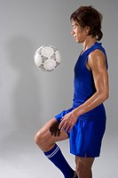 Soccer player juggling ball