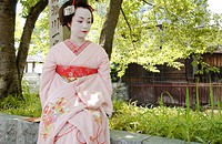A Geisha woman sitting