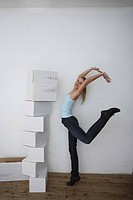 Woman standing by a stack of paper boxes