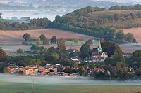 England, West Sussex, South Harting. Dawn mist surrounding the Village of South Harting on the South Downs.