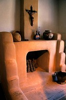 USA, NEW MEXICO, TAOS, BLUMENSCHEIN HOME & MUSEUM, INTERIOR, ADOBE FIREPLACE