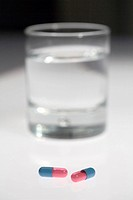 Pills and glass of water
