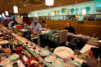 JAPAN, TOKYO, SUSHI RESTAURANT WITH CHEF PREPARING FOOD