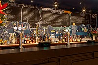 BIG CHILL BAR, LUCY TAUBER, BRISTOL, 2009, VIEW OF BAR, WITH BOTTLES DISPLAYED AND MENUS WRITTEN ON WALL