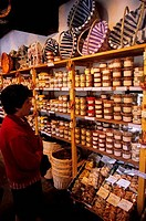 FRANCE, LOIRE REGION, CHENONCEAUX VILLAGE, STORE WITH LOCAL SPECIALTY FOODS, WOMAN SHOPPING