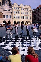 CZECH REPUBLIC, PRAGUE, OLD TOWN SQUARE, PEOPLE PLAYING GIANT CHESS GAME