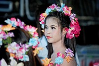 head shot of a young and beautiful Thai dancing girl with flowers in her hair