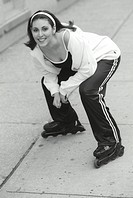 Young woman smiling, portrait, rollerblades