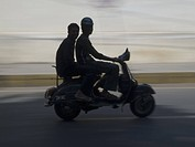 Two teenagers on motorscooter