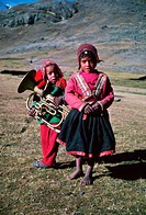 Young Peruvian highland musician and girl dwell at the upper limit of human habitation, 15,000 feet altitude, just under the glaciers of Cerro Ausanga...