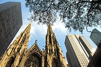 Saint Patrick's Cathedral beside the Olympic Building on the left. Midtown East, Manhattan,  New York, New York. USA