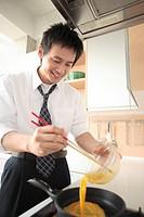 Businessman cooking in kitchen