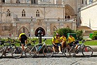 Cyclists in front of cathedral, Burgos, Castilla-Leon, Spain
