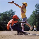 Two ethnic boys playing baseball