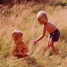 Young boy and girl in the meadow