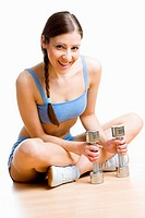 woman with dumb bells at gym