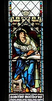 A stained glass window BY Edward Burne-Jones, depicting Saint Matthew, St Andrew's Church, Stratton, Cornwall
