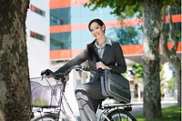 Woman in suit on bicycle (thumbnail)