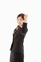 Businesswoman pumping fist