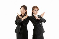 Two businesswomen standing with arms crossed