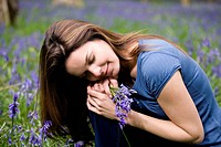 A young woman holding a bunch of bluebells (thumbnail)