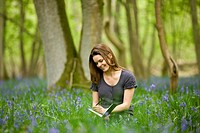 A young woman sitting amongst bluebells, drawing (thumbnail)